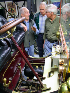 Seen here is Paul Carter explaining the intricacies of operating a White, a car that runs completely on steam!